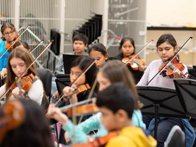 Orchestra students rehearse for an upcoming performance.